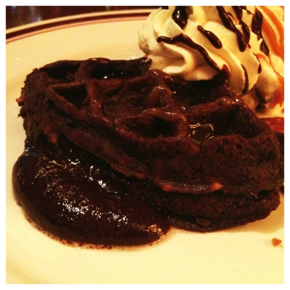 Four girls at a table. Please believe there was dessert! My sis and I split this puddle of chocolate love - flourless chocolate waffle with coffee gelato. Oh my.